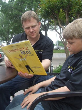 "Todd Burpo reads ""Heaven Is For Real"" to his youngest son Colby. Staff photo by Petrina J. Johnson"