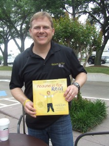 "Todd Burpo, author of  ""Heaven Is For Real,"" poses with a copy of his book. Staff photo by Petrina J. Johnson"